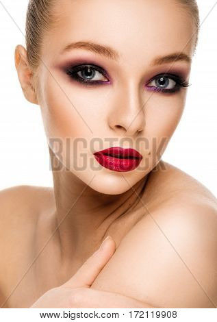 Beautiful Woman Touching Her Shoulder. Beauty Portrait. Bright Colourful Makeup.