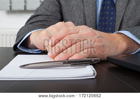 Close up picture of a businessman's hands at the office