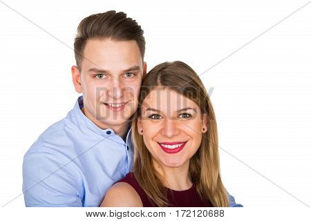Picture of young loving couple posing on an isolated background