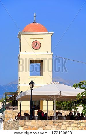 IERAPETRA, CRETE - SEPTEMBER 18, 2016 - Pavement cafe with the church tower to the rear Ierapetra Crete Greece Europe, September 18, 2016.