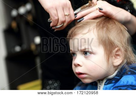 Pensive Child Having A Haircut First Time