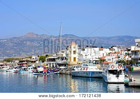 IERAPETRA, CRETE - SEPTEMBER 18, 2016 - View of the harbour with the church and town to the rear Ierapetra Crete Greece Europe, September 18, 2016.