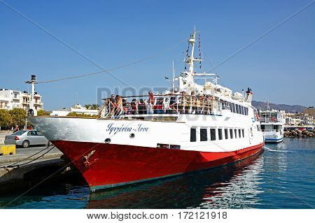 IERAPETRA, CRETE - SEPTEMBER 18, 2016 - People on a tour boat moored in the harbour Ierapetra Crete Greece Europe, September 18, 2016.