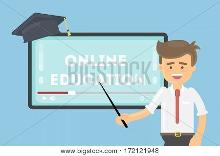 Online education concept. Teacher with pointer shows at the screen. Graduating hat.