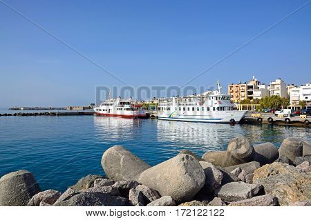 IERAPETRA, CRETE - SEPTEMBER 18, 2016 - Tour boats moored in the harbour with Kales fort to the rear Ierapetra Crete Greece Europe, September 18, 2016.