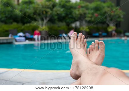 Man Feet At Swimming Pool