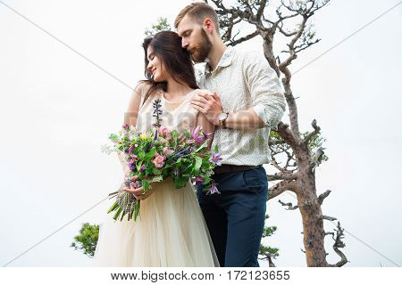 Happy Young Couple In Love Outdoors. Beautiful Mountains View. Love And Tender. Wedding Inspiration