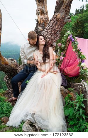 The Bride And Groom On Nature In The Mountains,  Fine Art Wedding Couple, Luxury Ceremony At Mountai
