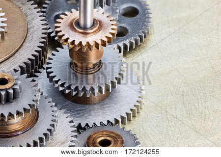 Industrial Cogwheels On Scratched Brass Background Macro