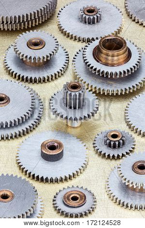 set of different gear cogwheel details on scratched industrial background