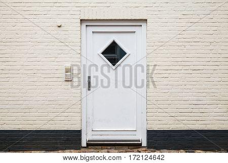 White Wooden Door In Brick Wall, Texture
