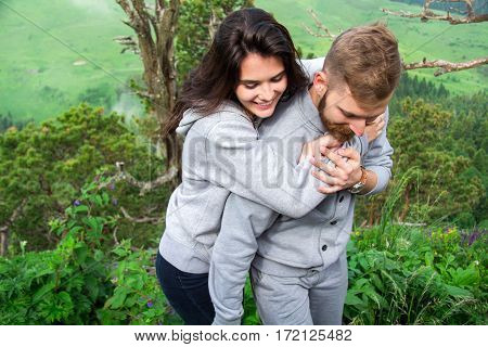 Portrait Happy Smiling Couple In Love, Beautiful Couple Embraces In Mountains