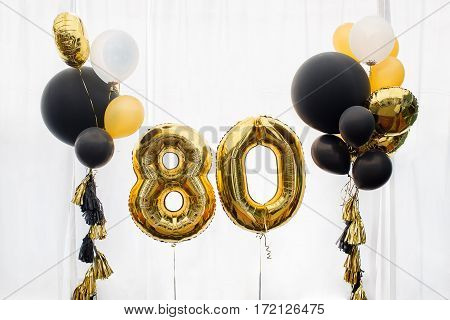 Decoration for birthday, anniversary, celebration of the eight hundred anniversary, white background, gold and black balloons with tassels