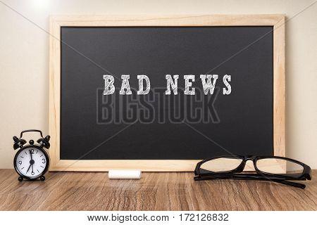 BAD NEWS word on chalkboard with chalk.