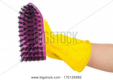 Close up picture of a purple cleaning brush held by a woman wearing yellow gloves