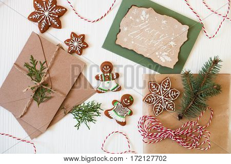 Merry Christmas! Xmas Cookies, Gingerbread Man, Ribbon, Card, Festive Decoration, Fir Branches On Wh