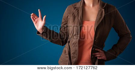 Young woman pressing imaginary button