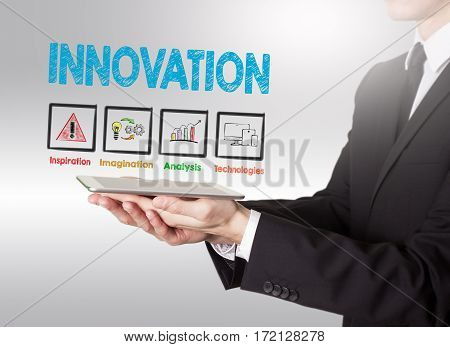 Innovation concept, young man holding a tablet computer.