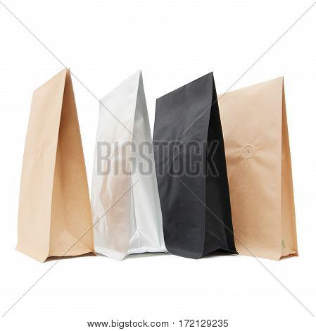 Black White and Brown Kraft Paper Bags. Blank Side Gusset Foil Coffee Bags With Degassing Valve Isolated on White Background. Packaging template mockup collection. Clipping Path. Aluminium coffee package. PBi Block Bottom Bags