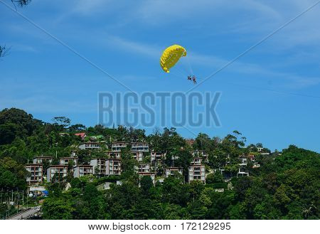 People Playing Parasailing In Phuket, Thailand
