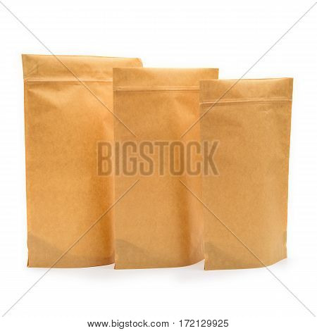 Three Brown Kraft Paper Bags. Blank Side Gusset Foil Coffee Bags Isolated On White Background. Packa