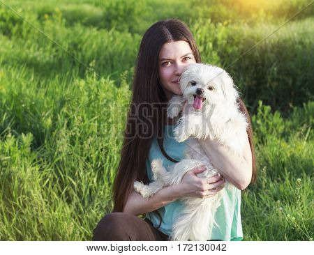 Beautiful Brunette With A Young Dog Enjoying A Beautiful Day