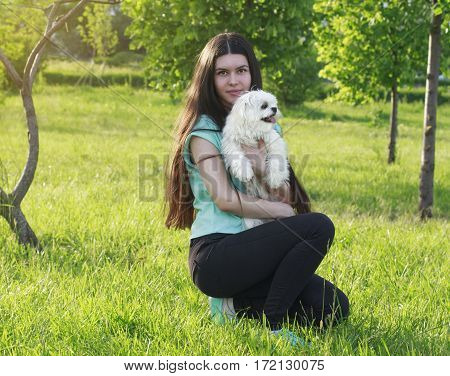 Beautiful Girl With A Young Dog Enjoying A Beautiful Day