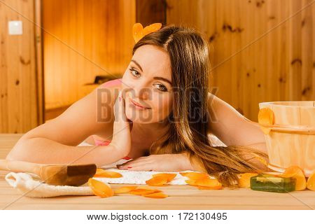 Woman Relaxing In Sauna. Spa Wellbeing.