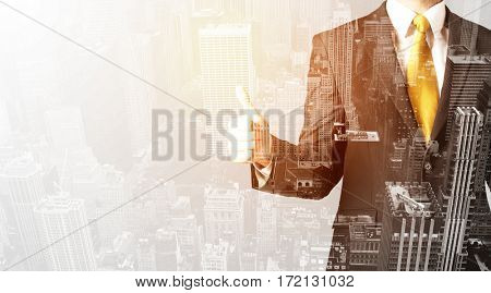 Business man with warm color overlay of city background texture