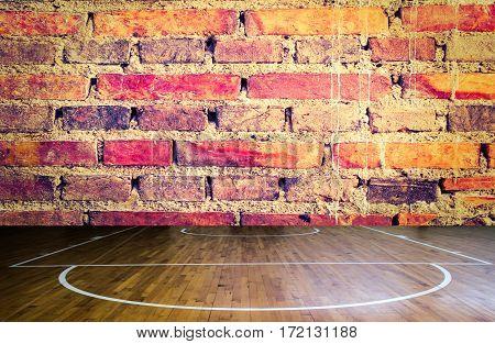 Close up wooden floor basketball court brick wall