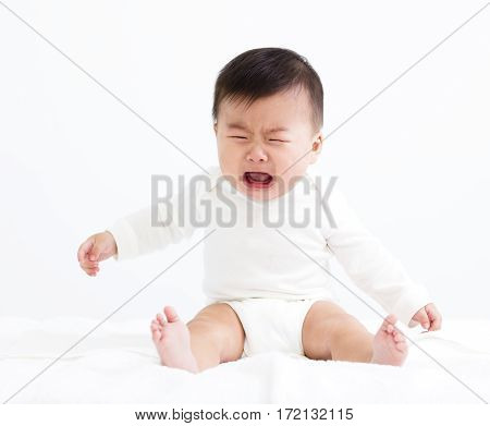 Crying asian baby boy isolated on white