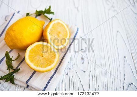 Juicy Lemons With Leaves Mint On A White Wooden Background. Lemon Slices. Fresh Lemon. Fresh Citrus