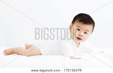 side view of happy crawling baby isolated