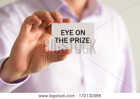 Businessman Holding Card, Text Eye On The Prize