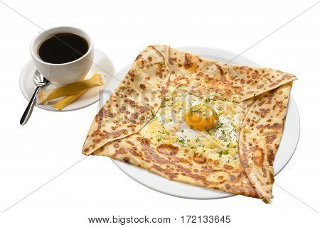 Ajarian traditional baked meal khachapuri with cheese, egg and yellow yolk and cup of  strong coffee on white isolated background