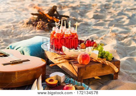 Picnic On The Beach At Sunset