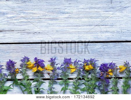 wildflowers on a wooden surface.the unpretentious rustic background