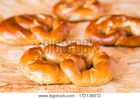 Cooked pretzel over the greaseproof paper ready to be eat