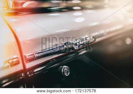 Closeup of a vintage car in sunlight