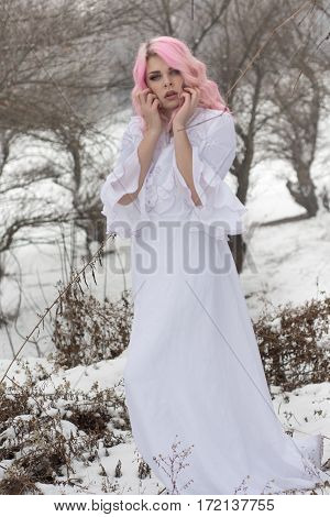 Winter Portrait Of A Yong Sensual Girl In White Dress At The Snow Forest.