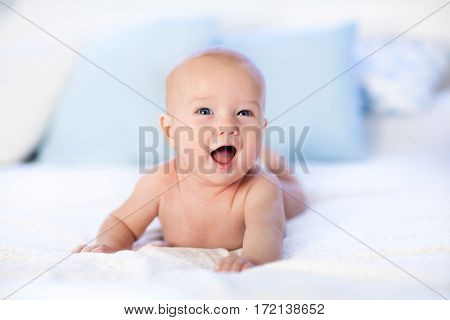 Baby In Diaper In Bed. Newborn At Home.