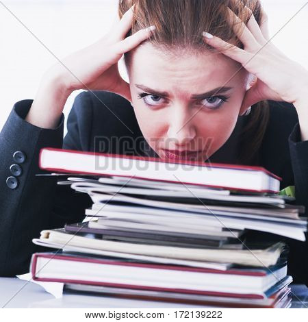 I hate my office work. Businesswoman in problems. Alone working in office with a lot of documents. Yelling and screaming for bad results. (psychological portrait aggression anger frustration)