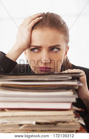 I hate my office work.I need to change. Young businesswoman working with documents. Low wages overtime working hours lack of career prospects unfreedom concept. (Body language gestures psychology)