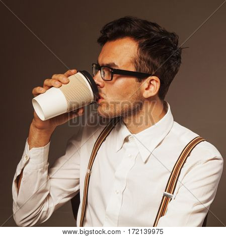 Coffee Break. Sucessful businessman enjoying in a cup of coffee (place for text)