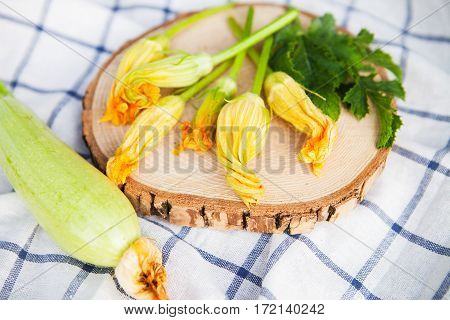 Fresh Zucchini With Flowers On A White Towel