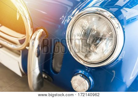 Closeup of a vintage blue sport car in the sunlight