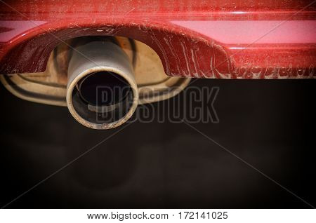 Close up Car Exhaust with dirty trunk