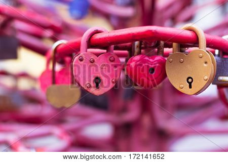 Old Padlocks Heart Shaped On Blurred Background