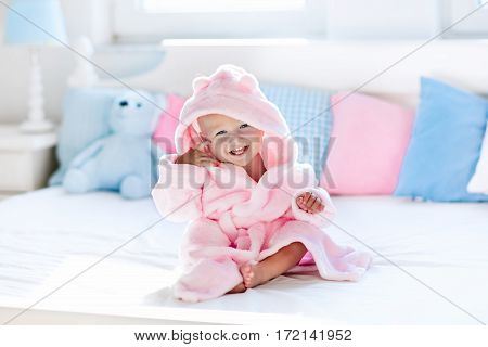 Baby In Bathrobe Or Towel After Bath
