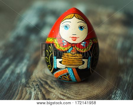 Close up of Russian traditional Doll. Wooden russian art. Homemade figure